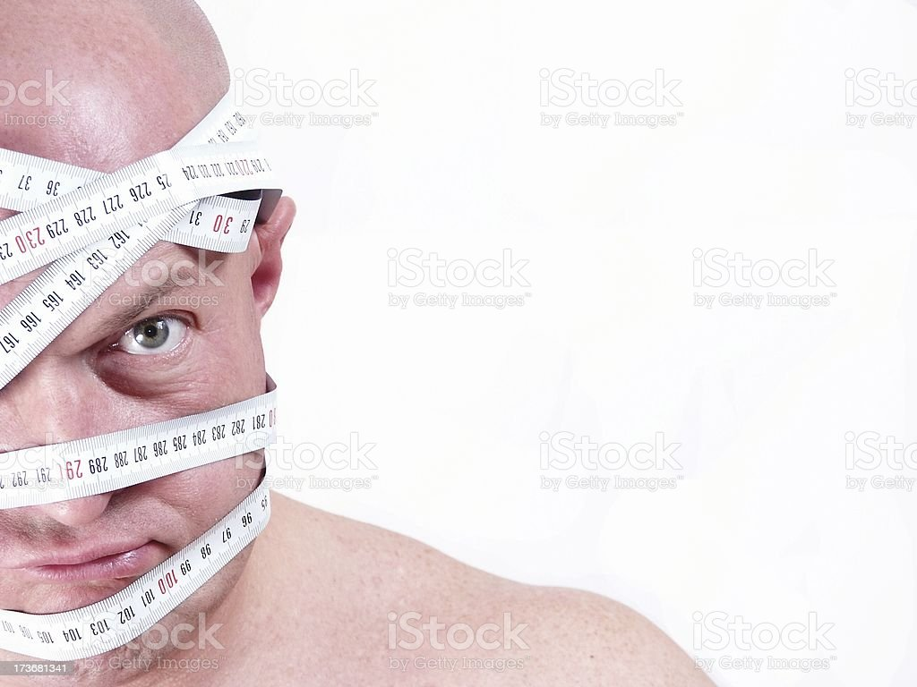 man braided with tape-measure royalty-free stock photo