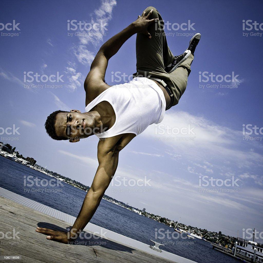Man Break Dancing on Pier royalty-free stock photo