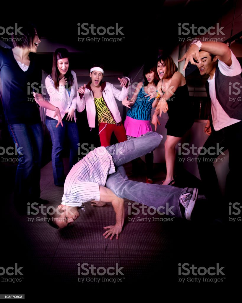 Man Breakdancing with Crowd of People Cheering Him On royalty-free stock photo