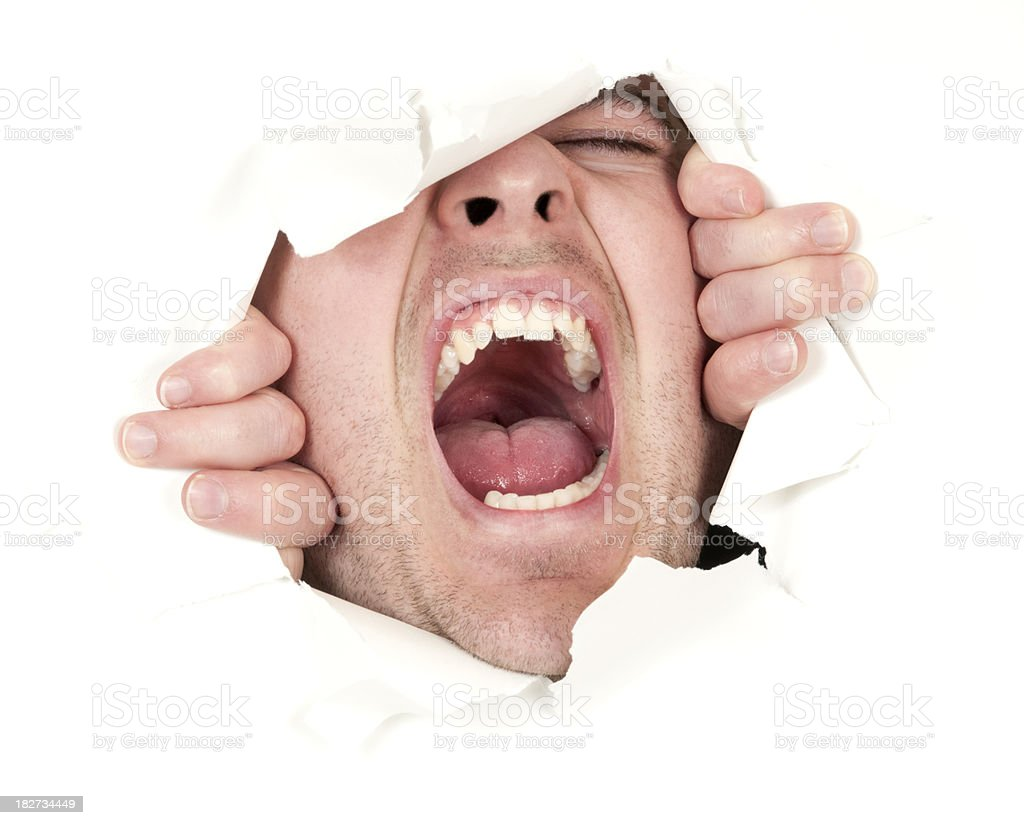 Man breaks through white paper and screams royalty-free stock photo