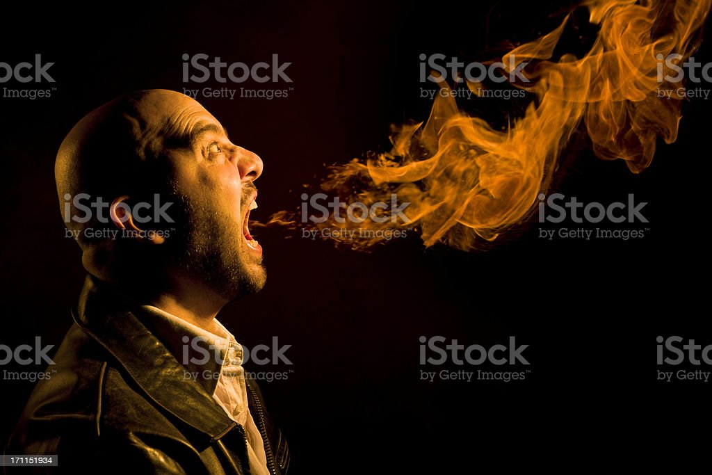 Man Breathing Fire - Heartburn, Bad Breath, or Anger stock photo