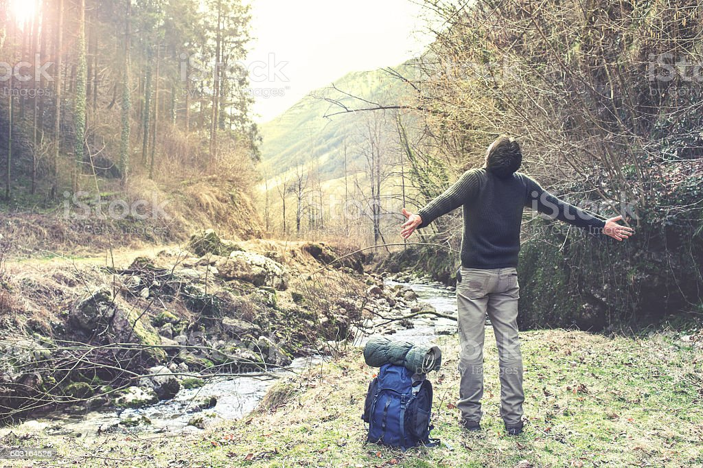 Man breathing in the forest under light stock photo