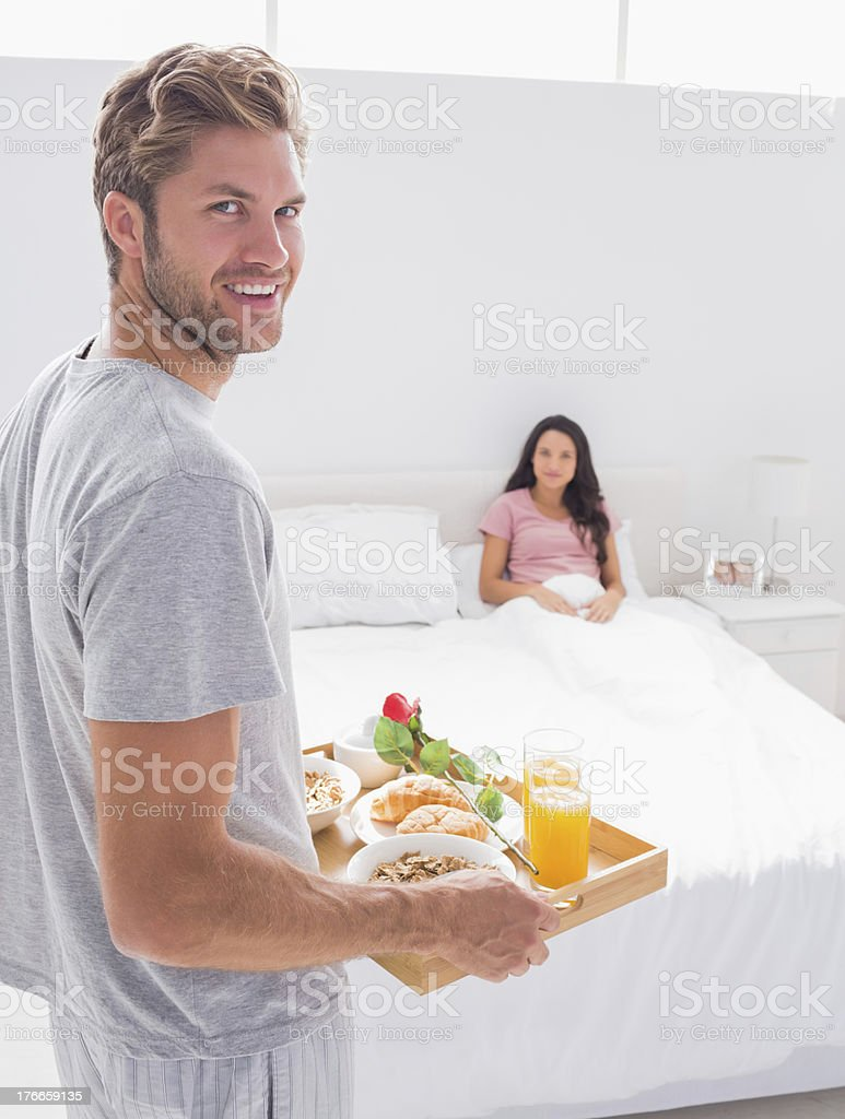 Man bringing breakfast to his wife royalty-free stock photo