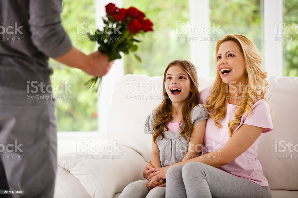 Man bringing flowers for family stock photo