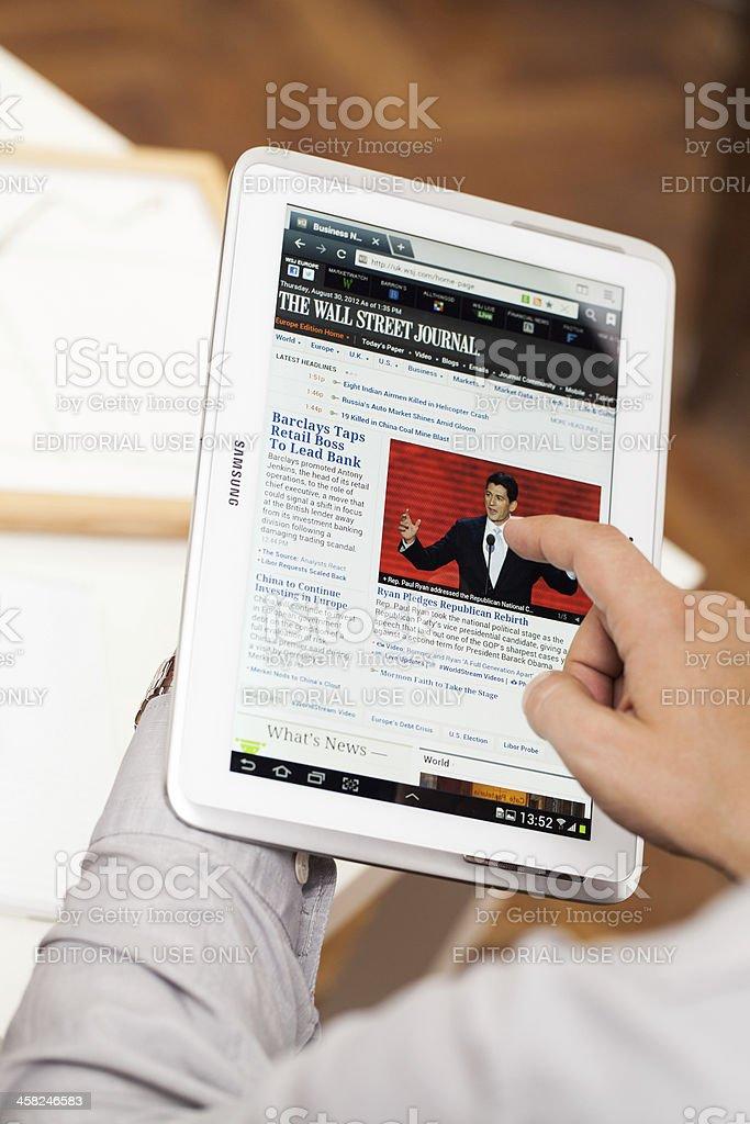 Man browsing on Samsung Galaxy Note 10.1' - N8000 stock photo