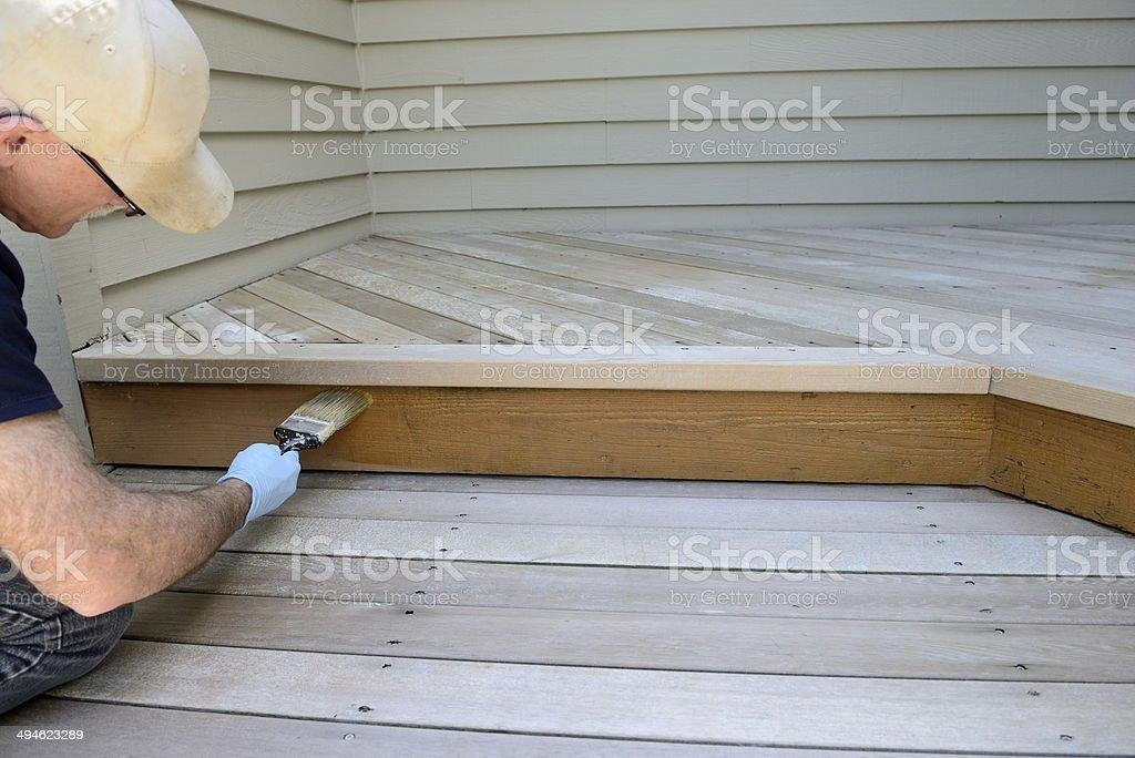 Man Brushing on Stain stock photo