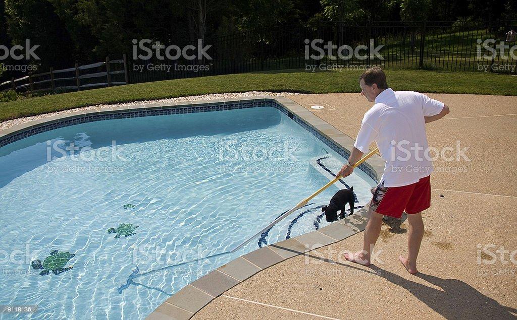 Man brushing pool stock photo