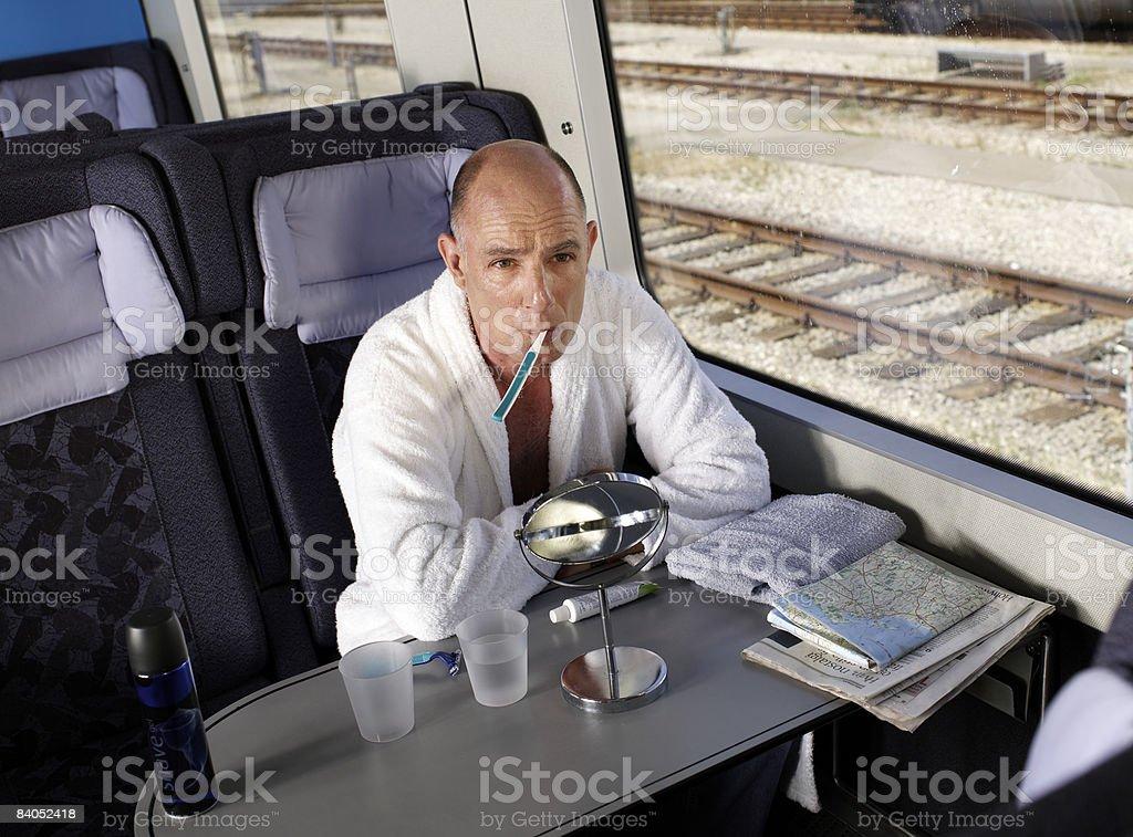 Man brushing teeth on train stock photo