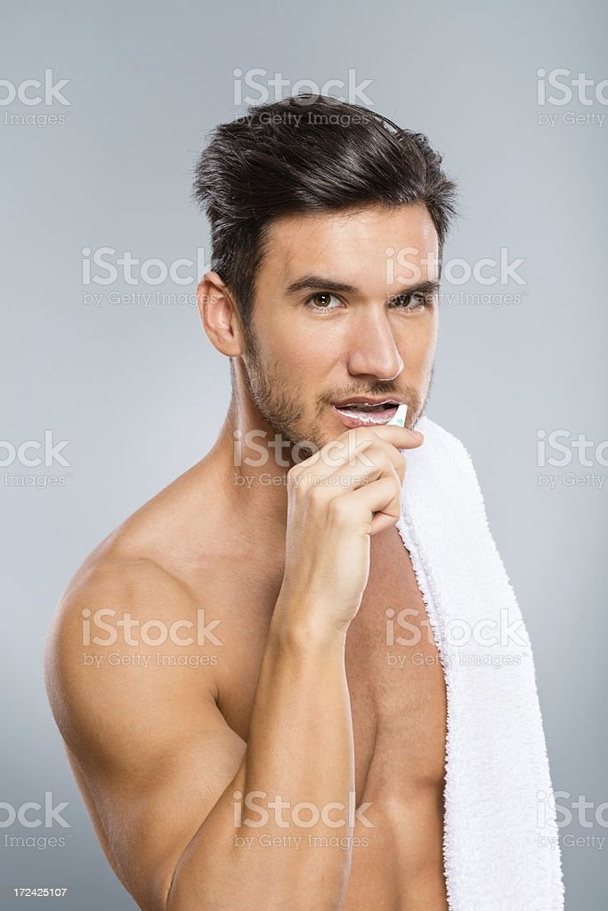 Man brushing teeth royalty-free stock photo