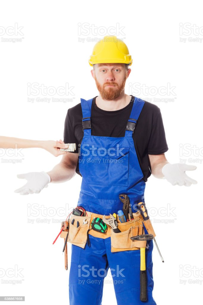 Man builder in the jumpsuit, isolated stock photo