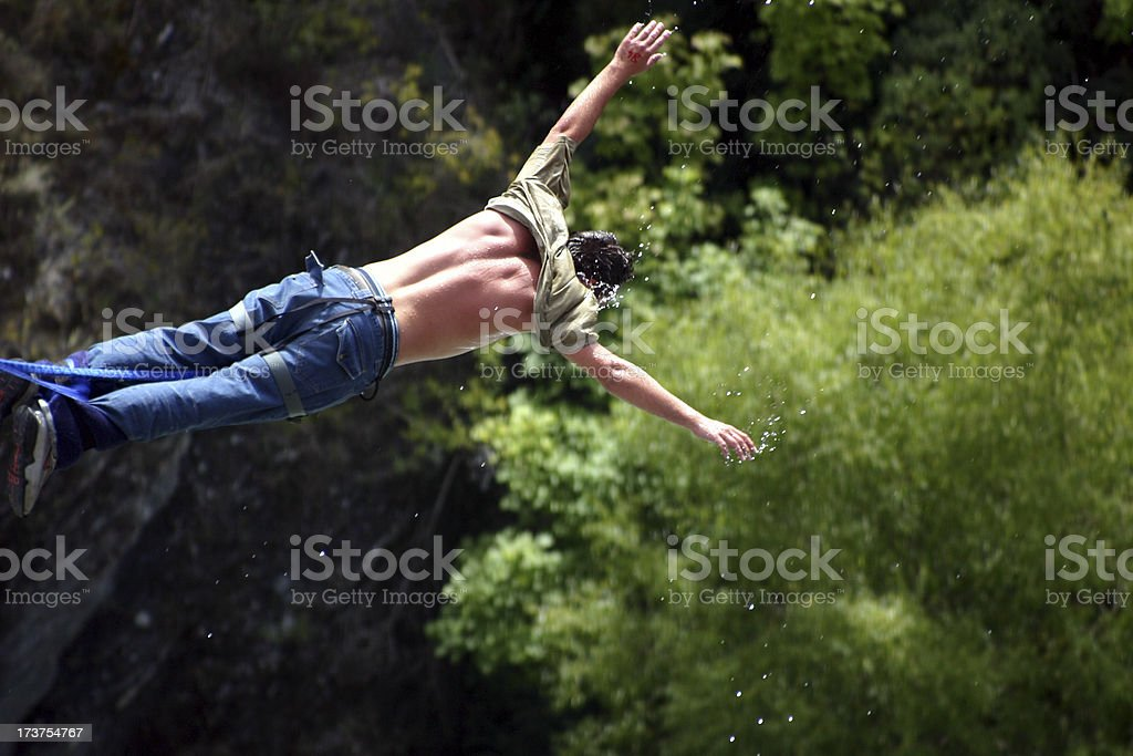 man bungee jumping in free fall stock photo