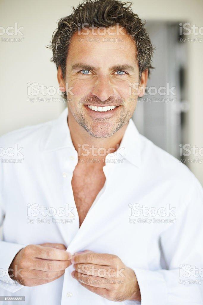 Man buttoning shirt royalty-free stock photo