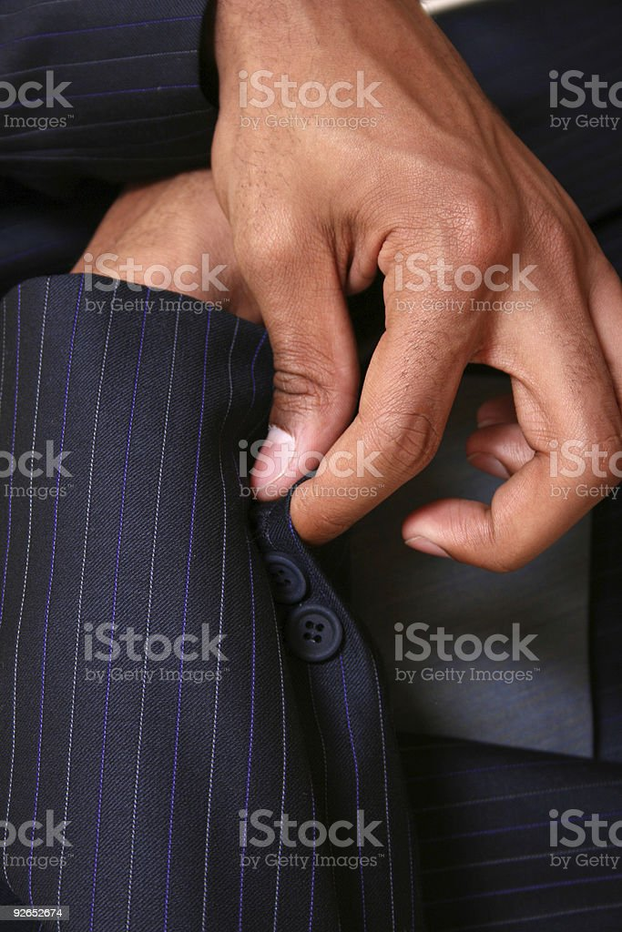 Man Buttoning Sleeve on Suit Jacket - Close-Up royalty-free stock photo