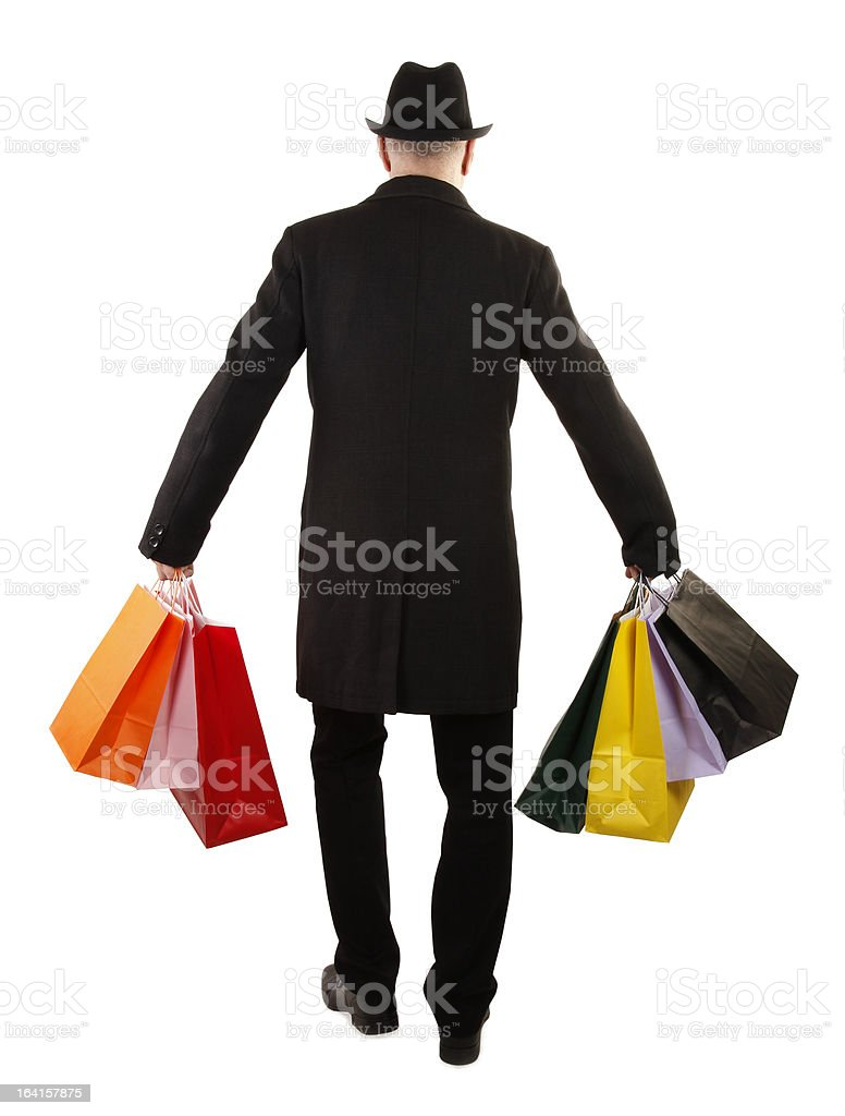 Man buyer is holding colorful shopping bags royalty-free stock photo