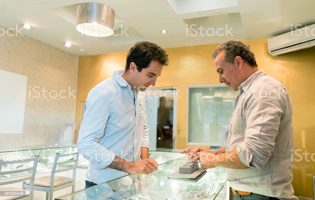 Man buying an engagement ring stock photo