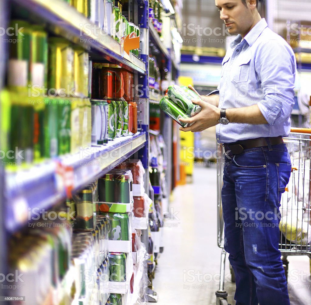 Man buying beer in supermarket. royalty-free stock photo