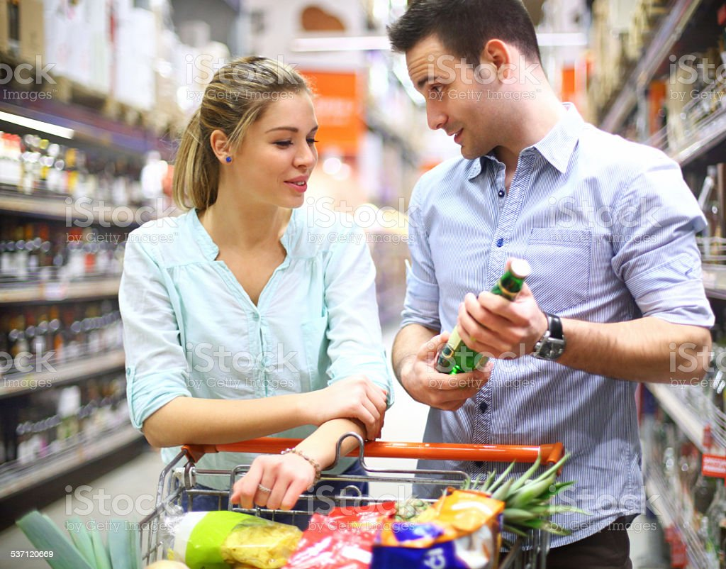 Man buying beer in supermarket. stock photo