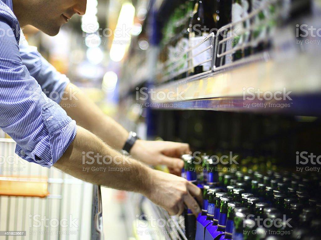 Man buying beer. stock photo