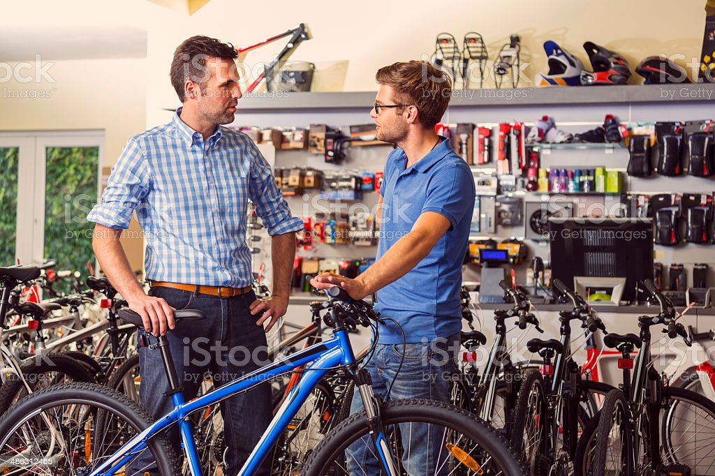Man buying bicycle stock photo