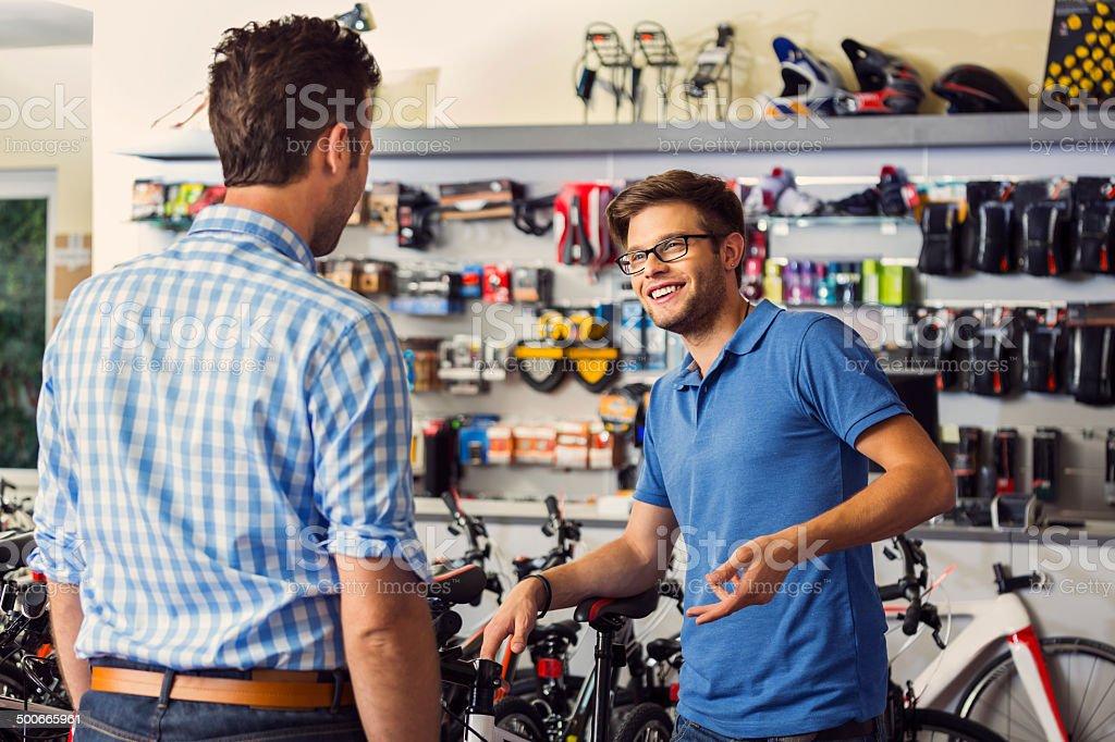 Man buying bicycle stock photo