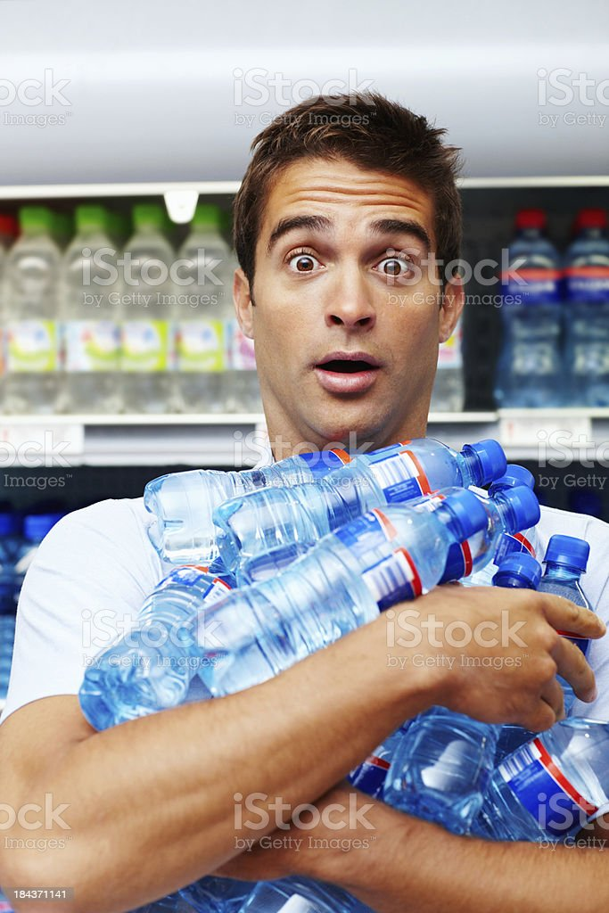 Man buying bottles bulk royalty-free stock photo
