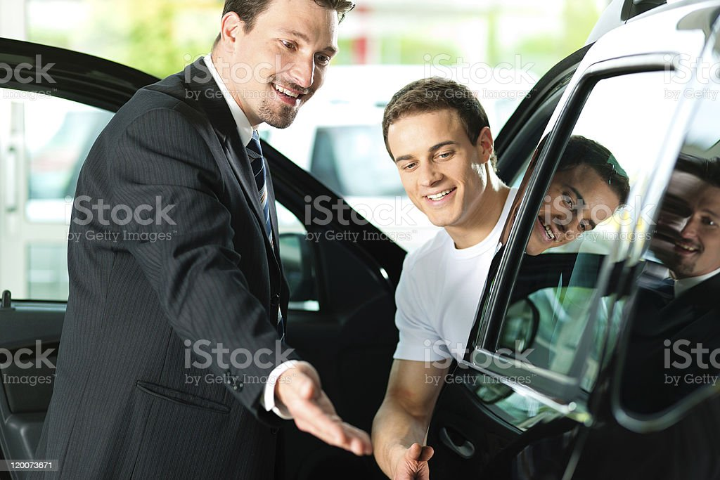 Man buying car from salesperson stock photo