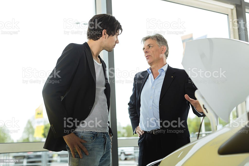 Man buying car from salesperson royalty-free stock photo