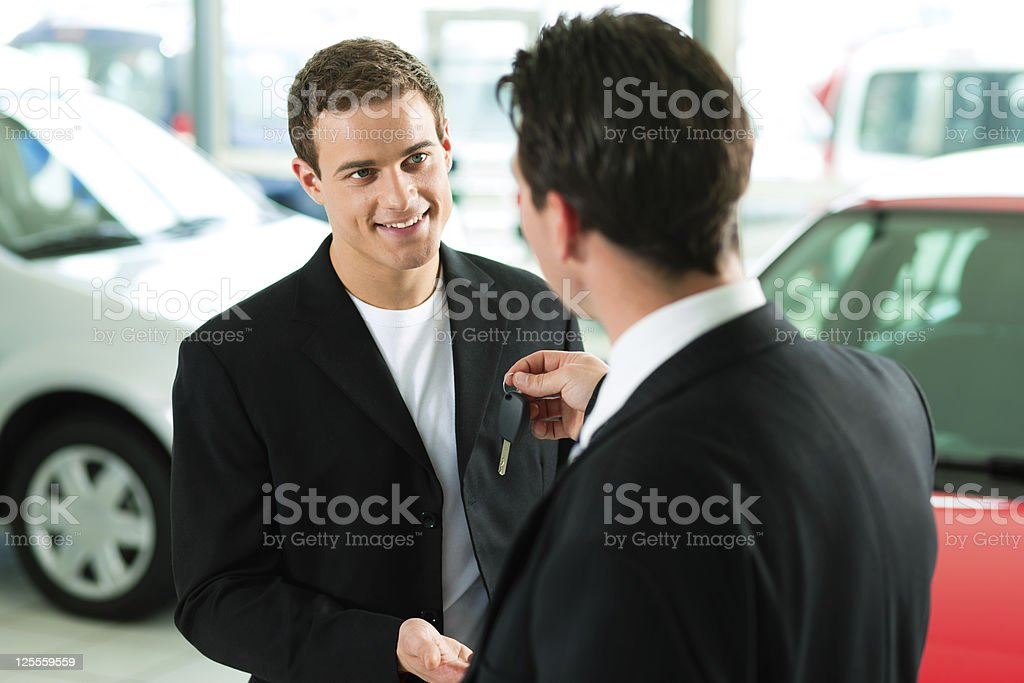 man buying car - key being given royalty-free stock photo