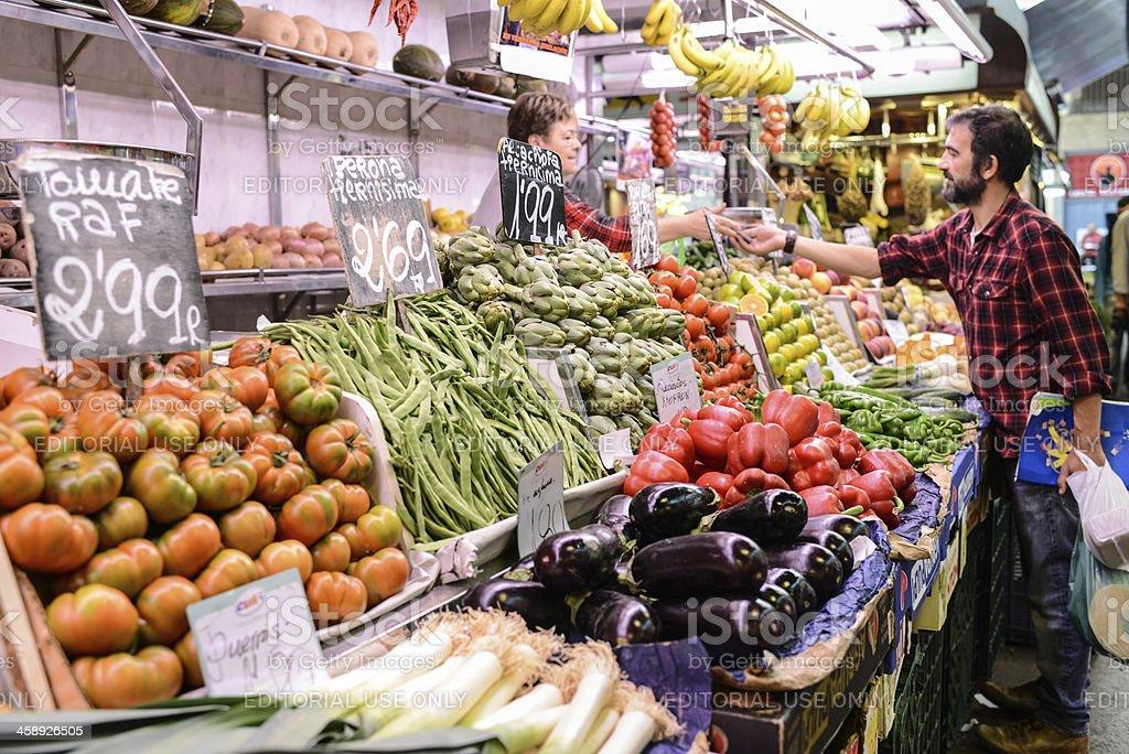 Man buying fresh veggies at La Boqueria Market, Barcelona royalty-free stock photo