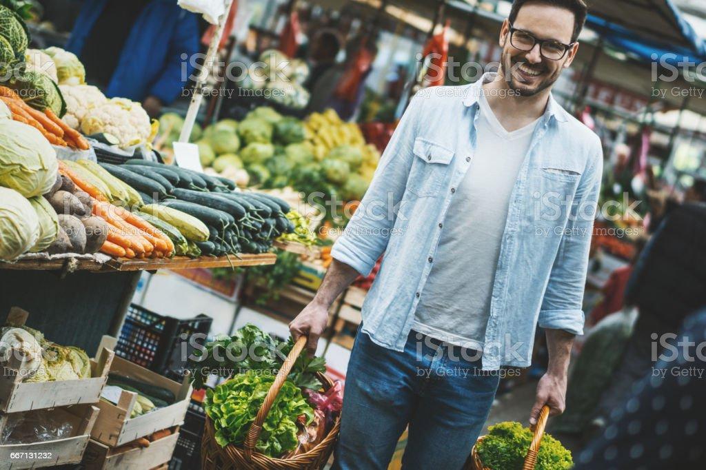 Man buying groceries at food market. stock photo