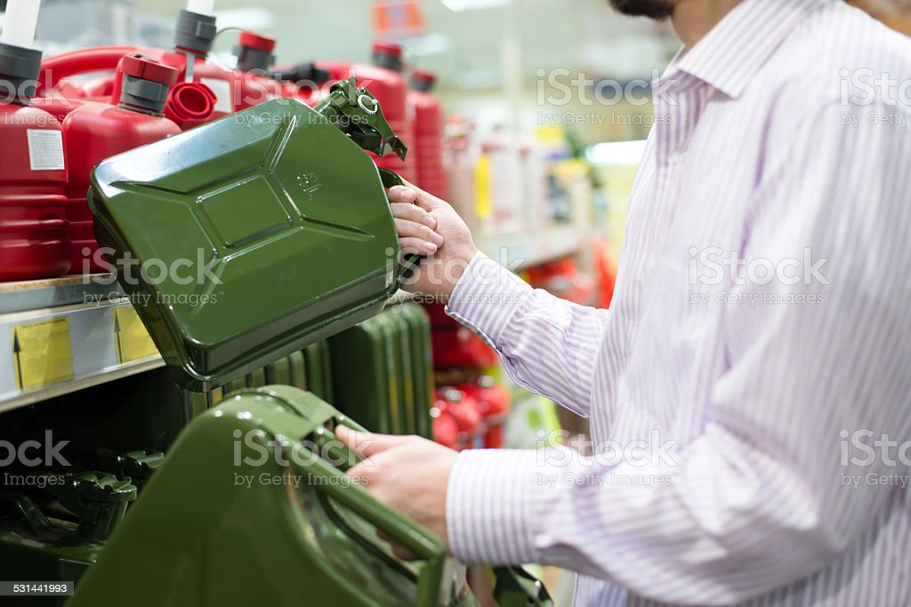 Man buying huge can for petrol stock photo
