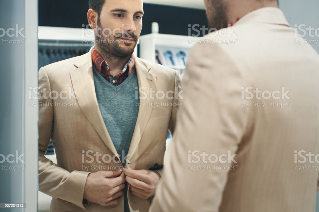 Man buying some clothes. stock photo