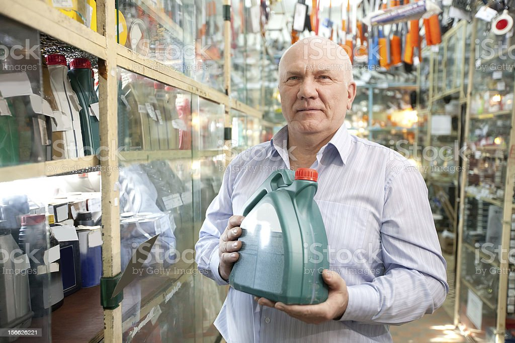 man buys automobile chemicals stock photo