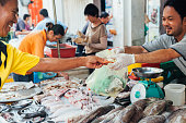 Man buys seafood at the local market