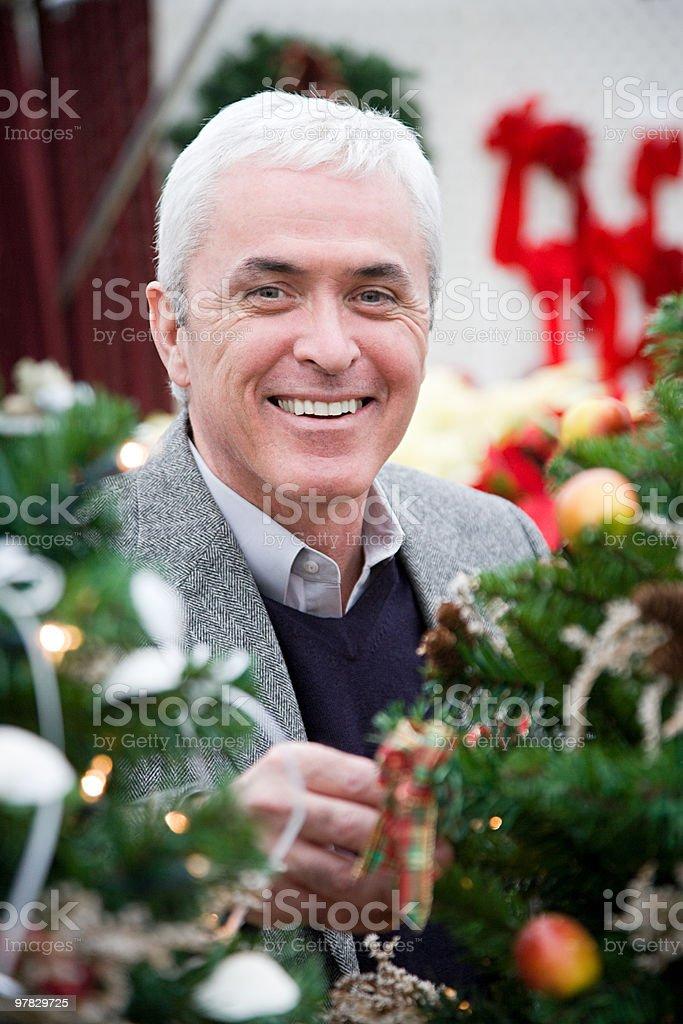 Man by christmas tree royalty-free stock photo