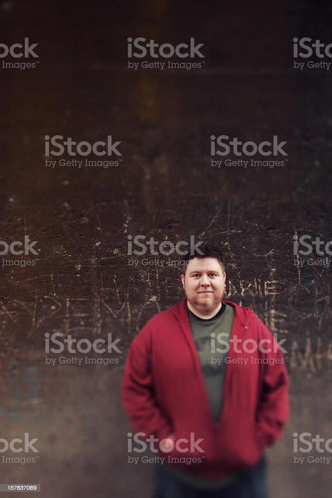 Man By Grunge Wall royalty-free stock photo