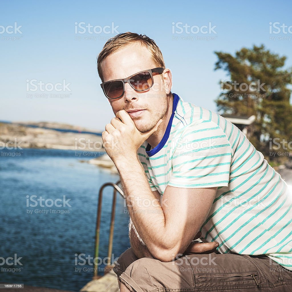 Man by the ocean coast royalty-free stock photo