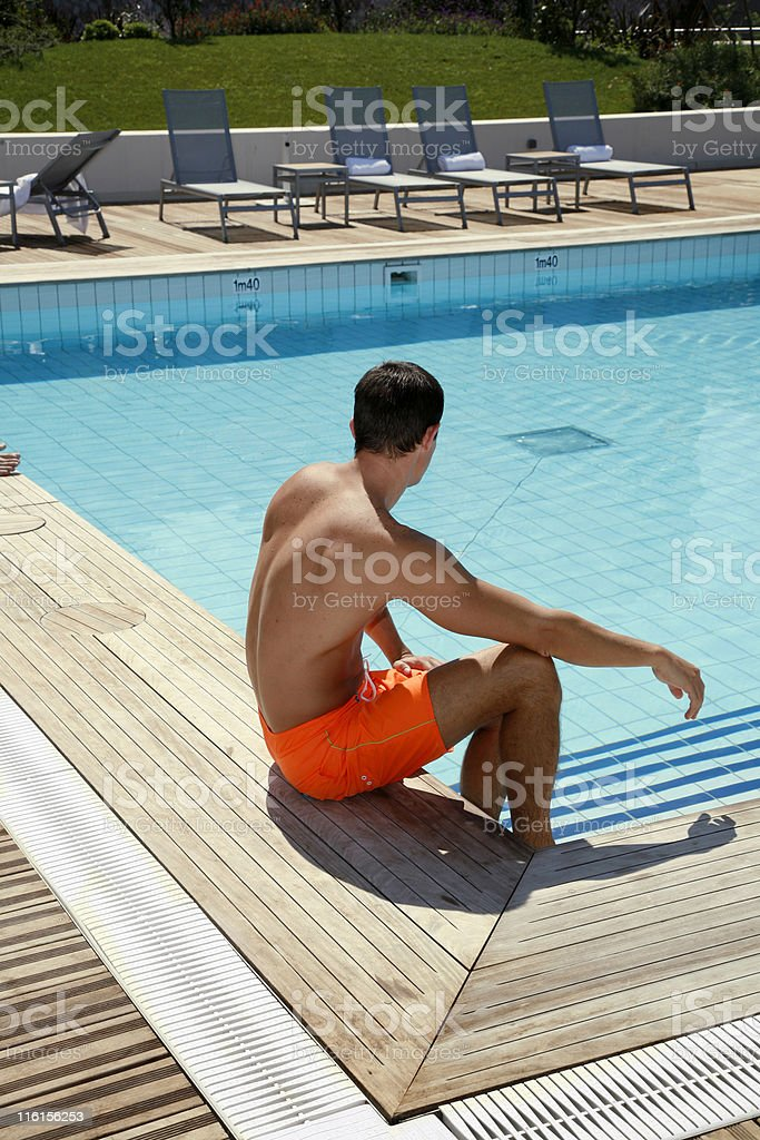 Man by the pool royalty-free stock photo