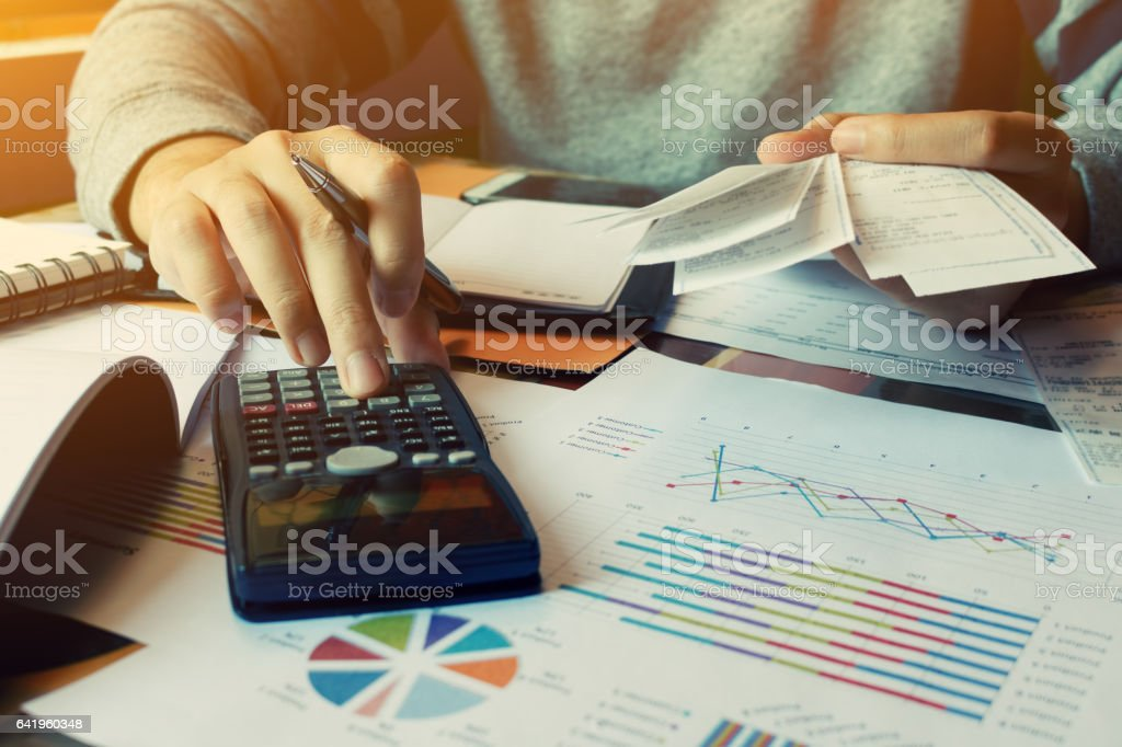 Man calculate invoice and receipt with report summary stock photo