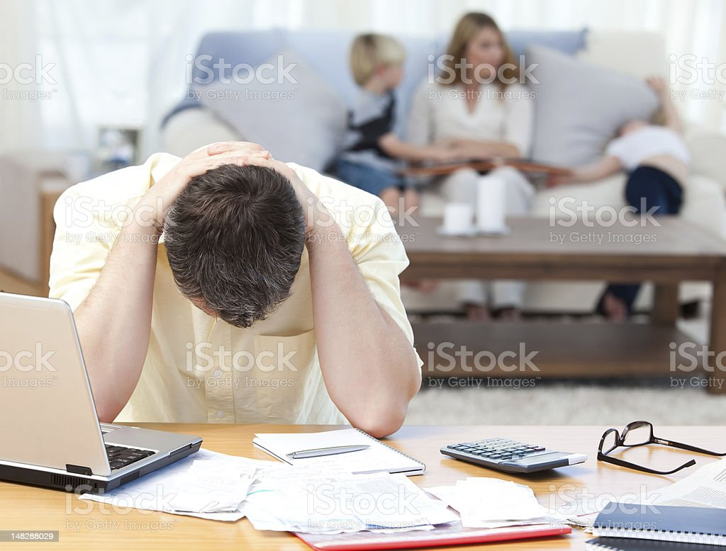 Man calculating his bills stock photo