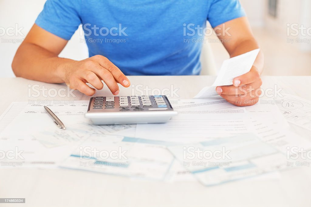 Man Calculating Household Bills royalty-free stock photo
