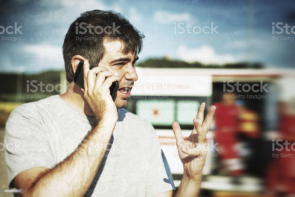 Man Calling Emergency Sercice stock photo