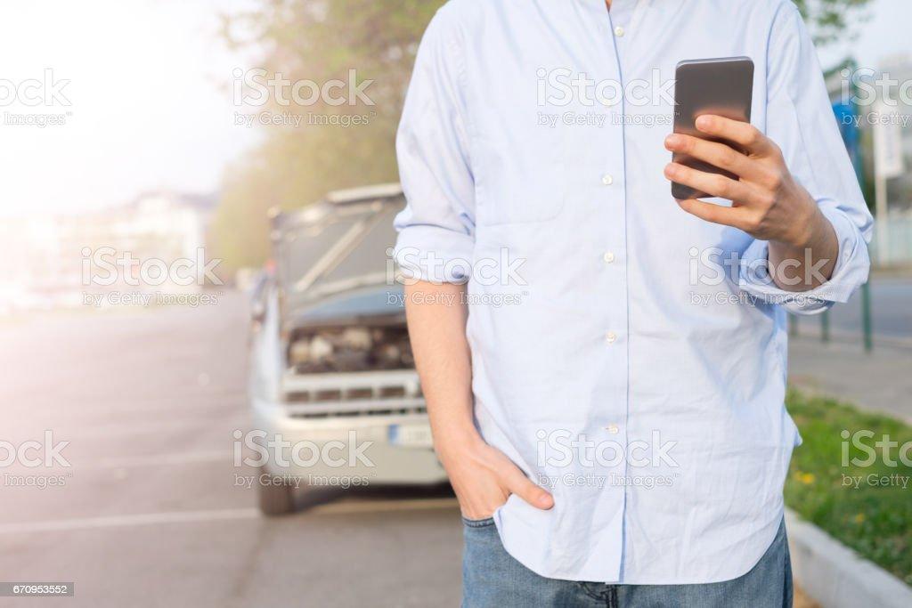 Man calling mechanic after car breakdown stock photo