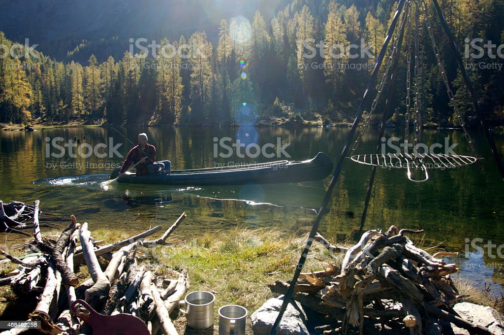 Man canoeing on lake stock photo