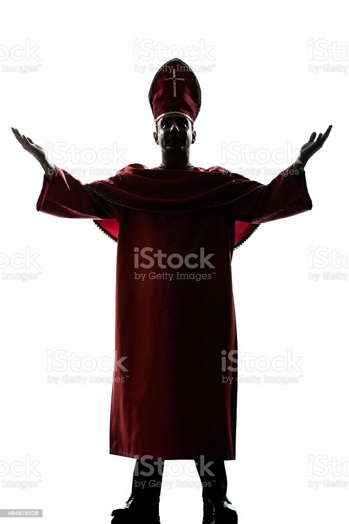 man cardinal bishop silhouette saluting blessing stock photo