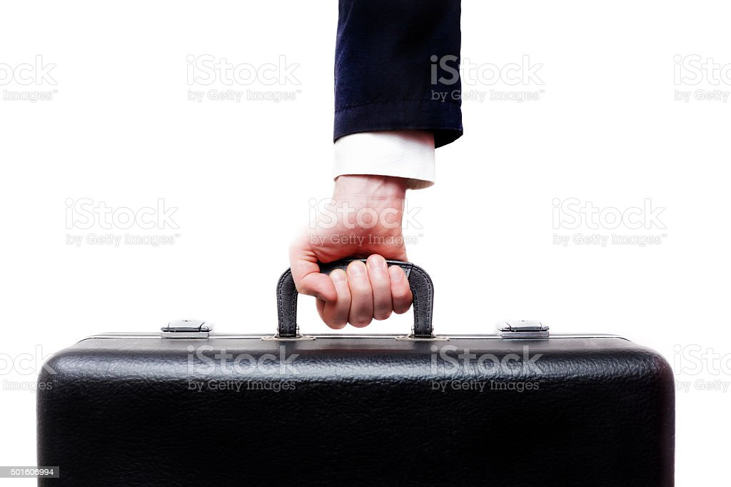 man carries a heavy suitcase stock photo