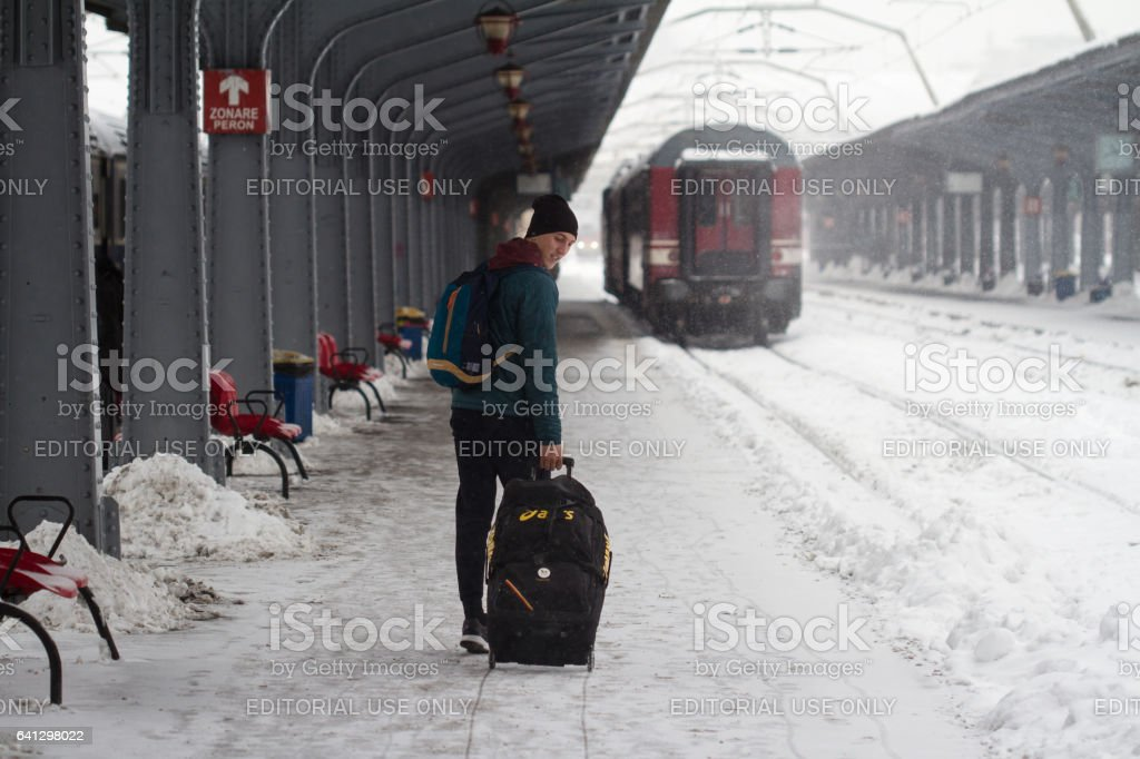 Man carries his baggage on heavy snow storm stock photo