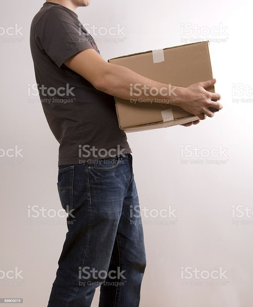 Man carrying a box royalty-free stock photo