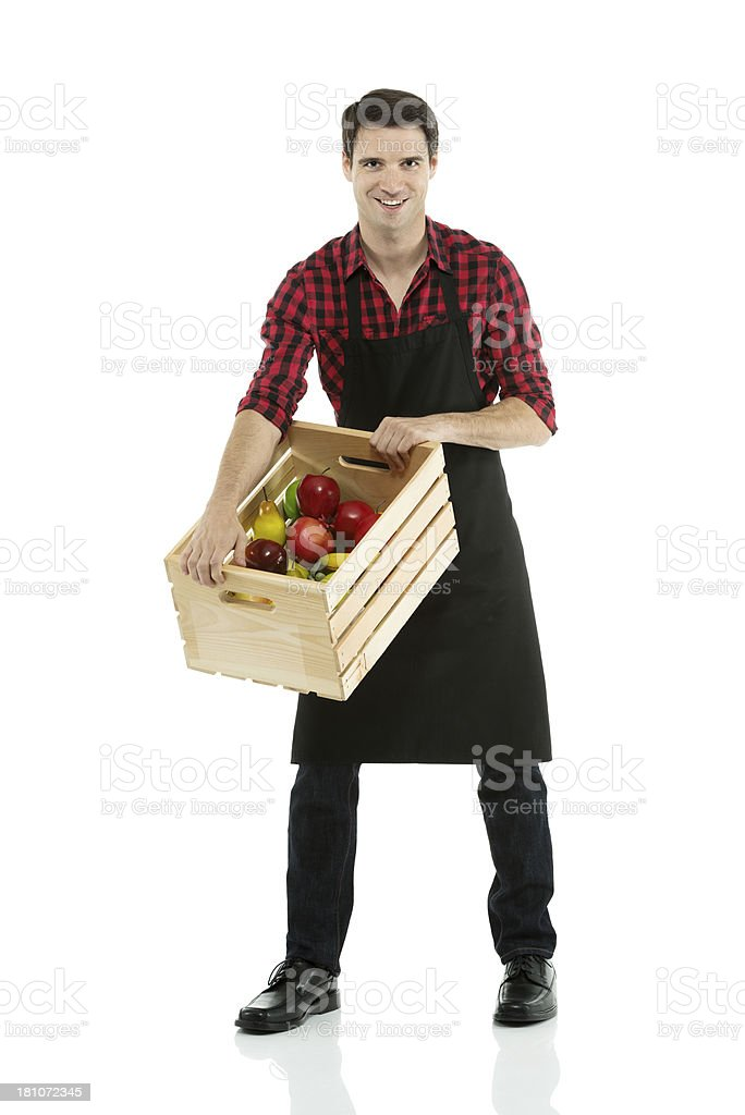 Man carrying a crate of fruits royalty-free stock photo