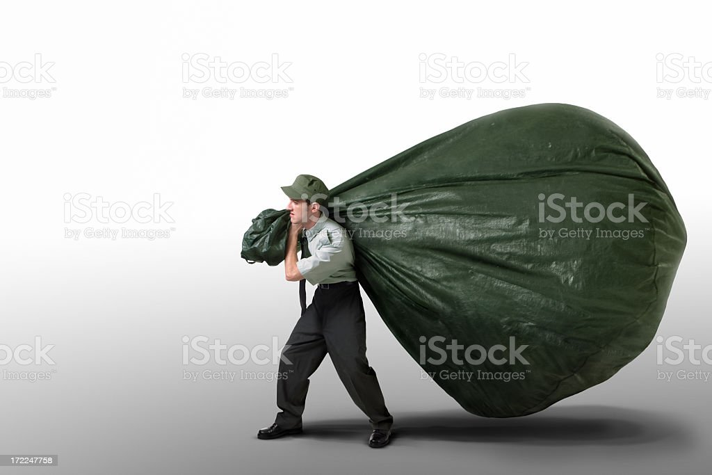 Man carrying a giant bag of garbage on a white background stock photo